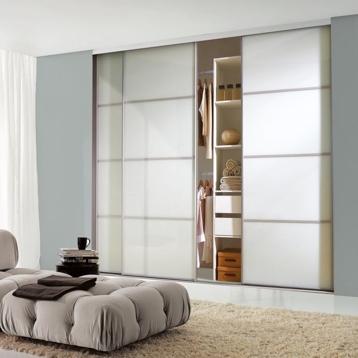 Classic white bedroom with sliding doors